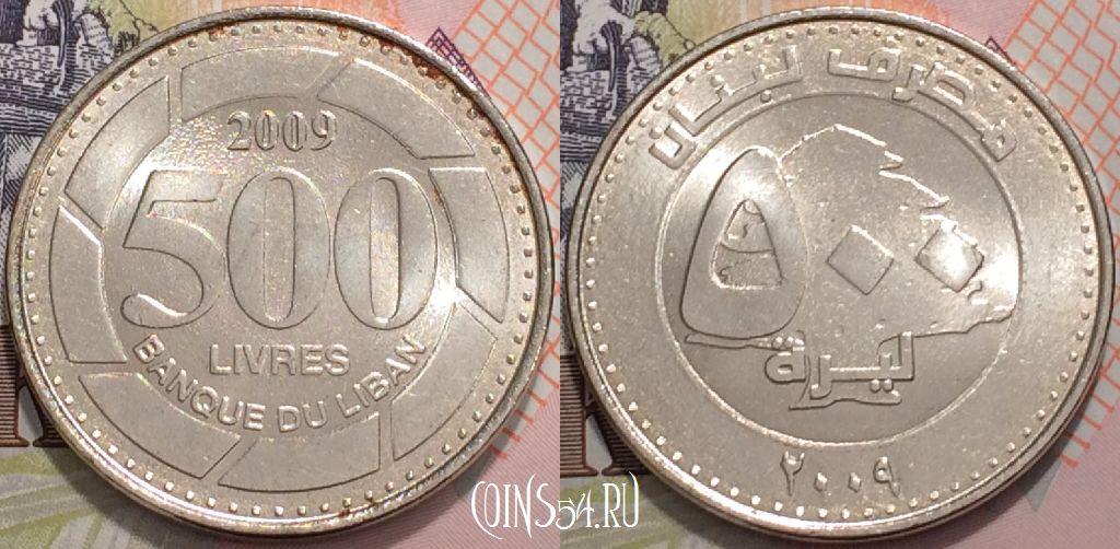 монета с отверстием в центре и иероглифами